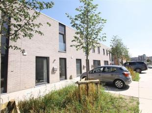 Site De Kien, gelegen in Kortrijk bij de oevers van de Leie. Deze nieuwbouw woning biedt alle comfort.<br /> Inkom, ruime woonkamer met een perfect in