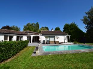 Heideroosje 8 - Stijlvolle villa met een bewoonbare oppervlakte van 300 m2 , gelegen in  zeer een residentiële verkaveling. De villa is volledig