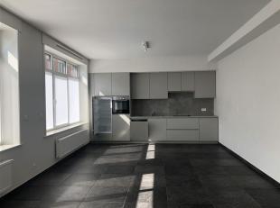 Appartement situé en face de la place de Templeuve. <br /> Bien idéal composé d'un grand living ouvert sur une super cuisine &eac
