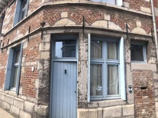 Maison très atypique situé proche du centre de Tournai.<br /> Cette charmante maison dispose d'un hall d'entrée avec une chambre