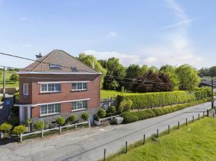 Voor een bezoek of meer info bel 054/69.39.34 - Op een rustige, landelijke locatie in Denderwindeke bevindt zich dit charmante landhuis op 33 a 80 ca.