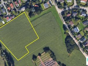 Wezembeek-Oppem: landbouwgrond grenzend aan de tuinen van een woonwijk met een oppervlakte van 11800m², volledig gelegen in agrarisch gebied.