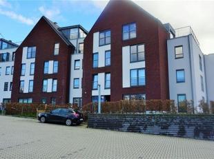 Appartement situé au rez de chaussée d'un immeuble récent comprenant un hall d'entrée, séjour ouvert sur une cuisin