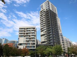 Europese wijk. Een fantastisch appartement 65m² in een gebouw daterend van 2014. Inkomhal met een gepantserde deur, living, Amerikaanse keuken in