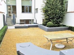 Quartier Châtelain<br /> Proximité Place du Châtelain, dans un bel immeuble de standing, superbe appartement avec grand jardin, am&