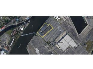 Gemengde industriele site gelegen in de haven van Gent.  Op de site bevinden zich drie loodsen (hal 1: 5.600 m²; hal 2: 7.390 m² met 300 m&s