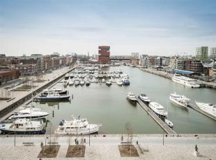 """Luxurious apartment in residence """"Het Koninklijk Entrepot"""" that offers a stunning view across the marina and the MAS. Entrance hall with a separate to"""