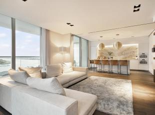 Hoogwaardig afgewerkt appartement op absolute toplocatie met fenomenaal uitzicht op de Schelde, het havengebied en de historische stad.