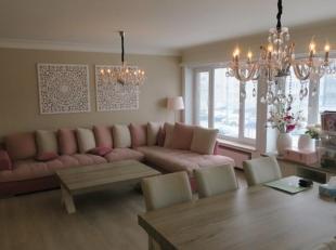Ruim en goed gelegen 2-slaapkamerappartement (ca 110m²) met terras en garage. IND: Inkomhal met vestiare; grote leefruimte met veel lichtinval; k