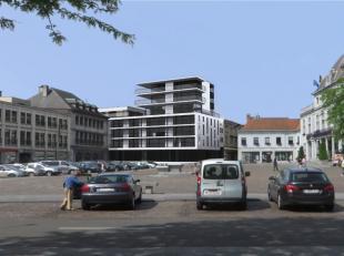Moderne handelsruimte met een oppervlakte van 110 m² te koop in een modern nieuwbouwproject gelegen op de Grote Markt van Ronse. Het gelijkvloers