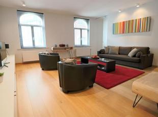 Appartement 130m²<br /> - Un living 60m² - plancher<br /> - Une cuisine ouverte toute équipée 16m²<br /> - Une chambre 16