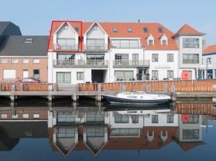 Recent en duplex appartement (118m2) met 2 slaapkamers en ruim zonneterras. Gelegen aan de Vaartdijk-Noord te Leffinge vlakbij het dorpsplein en met z