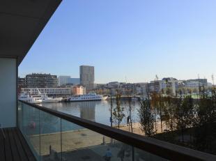 't Eilandje: Stijlvol GEMEUBELD appartement op de 1ste verdieping met zicht op het water in Toren 3 van de befaamde WESTKAAI torens. Hier woont U temi
