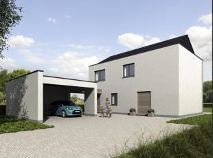 Nieuwbouwvilla in het mooie Buitenland op een perceel van 1252m² bestaande uit: inkomhal, toilet, woonkamer met mooi zicht op de tuin, bureel, ke