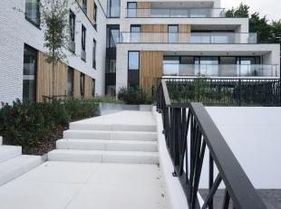 """In de luxueuze Residentie """"Blue Bell"""" aan de rand van het centrum van Lummen vindt u dit ruime nieuwbouwappartement op de eerste verdieping. 2 slaapka"""