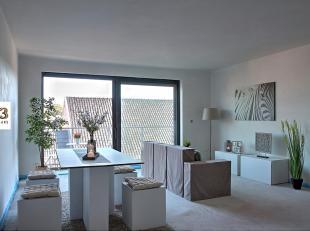 Dit appartement is gelegen op de tweede verdieping, te bereiken met de lift of de trap.<br /> Op een oppervlakte van 87,44m² vinden we een living