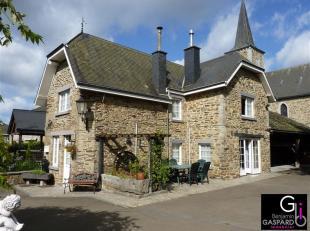 Fermette située à Bérismenil comprenant car port, hall d'entrée, wc indépendant, cuisine, buanderie, salle à