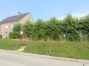 Goed gelegen Bouwgrond in Oplinter in directe omgeving van slager, bakker, banken, ... Op kleine afstand van het centrum van Tienen!Gelegen ter hoogte