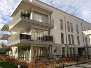 Zeer rustig gelegen, instapklaar nieuwbouwappartement in het centrum van Mol, Indeling: inkomhal, ruime woonkamer met open ingerichte keuken, 2 ruime