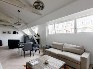 Beschrijving:<br /> Prachtigappartement met 2 slaapkamersvan84m² op dederde verdieping van een magnifiek historisch gebouw in de prestigieuze en