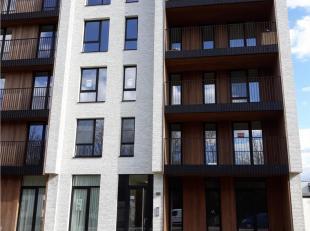 Nieuwbouwappartement Nr. 4.9 - 4°verdieping gelegen in Blok B2.  Bestaande uit: inkomhall, apart toilet, living met open keuken (kasten, enkele af