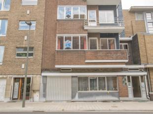 Karaktervol en ruim te renoveren gelijkvloers appartement met 2 slaapkamers, tuin, garagebox en 4 kelders (nrs.. 5,6,7 en 8)in een gebouw opgenomen in
