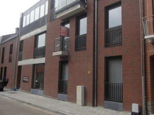 Poststraat 26 bus 0002 - D816A<br /> Inkomhal - Living - Berging<br /> Open Keuken met kasten, aanrecht, keramische kookplaten, combi-oven, dampkap, s