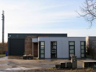 Dit gebouw is gelegen in de industriezone Genk-Noord, dichtbij de verbindingswegen E313 en E314.Het gebouw dateert van 2003 en bevindt zich in een uit