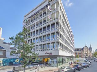 Maak een afspraak om ons modelappartement<br />  te bezoeken en geniet van een prachtig uitzicht!<br /> Het iconische gebouw van BNP Paribas Fortis aa