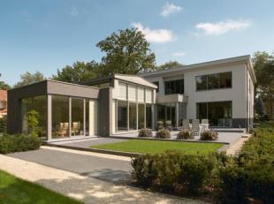 Prachtige villa (520m²) met binnenzwembad, gelegen op perceel van 3250m². Luxe afwerking!Volledige renovatie in 2004!- ruime heldere living