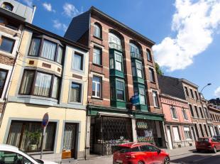 LIÈGE: Au cur de la ville, cet immeuble de rapport comprend 1 rez commercial, 2 appartements (1ch), 6 studios et 2 duplex.  Bâtiment avec