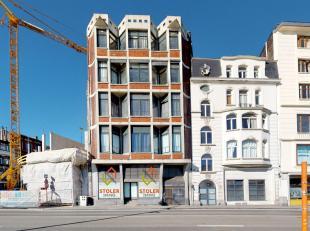 Rez de chaussée commercial de +/- 100 mètres carrés, composé d'un grand espace ouvert avec locaux à l'arrièr