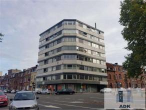 Rez de chaussée commercial (ancienne banque) d'une superficie de 125 m² comprenant une surface d'accueil, des bureaux réamén
