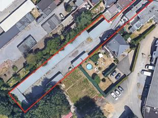 Sur les hauteurs de Grivegnée, un ensemble immobilier comprenant 32 box garages et un bungalow. Le bungalow est composé comme suit : hal