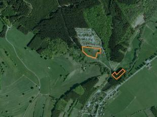 Parcelle de terrain en zone de loisirs : 9.653 m²; largeur : 150 m; profondeur : 70 m. et parcelle de terrain en zones agricole et foresti&egrave