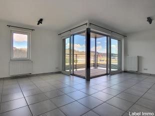 Magnifique appartement neuf  5ème étage  Vue sur MeuseAndenne, au cur du DOMAINE DE L'ARC-EN-CIEL. Cadre de vie exceptionnel dans le cen
