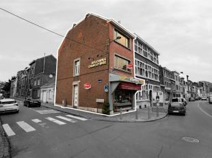Maison de commerce et d'habitation, en très bon état, située à proximité des arrêts de bus et dans une rue pr