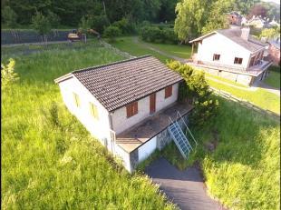 BOMAL: Bungalow avec garage sur 11a50. Petite rue calme, belle vue. Composition: séjour avec cuisine ouverte, salle de bain, deux chambres, d&e