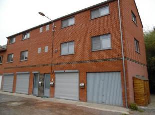 700euro/mois Très joli appartement de 85M2 avec garage et terrasse de 40M2 compr hall buanderie living cuis équipée hall/nuit wc