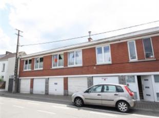 Appartement 1er étage avec petite cave et garage : hall, living, cuisine équipée, sdb, wc, 2 chambres, petite buanderie. CC gaz,