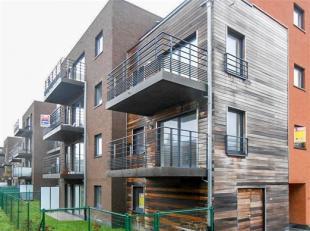 Situé en plein centre ville de Tournai, appartement neuf comprenant : Hall d'entrée, toilettes, living, cuisine équipée ou