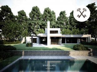 Dit ruim huis (300m² bewoonbare oppervlakte) is gelegen op een centrale locatie, midden in het groen met prachtig zicht op het water (vijver) en