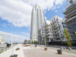 Adembenemend 2 slaapkamer appartement dat volledig bemeubeld is en zich bevindt op de 22ste verdieping in de Up-site; de grootste woontoren van Belgi&