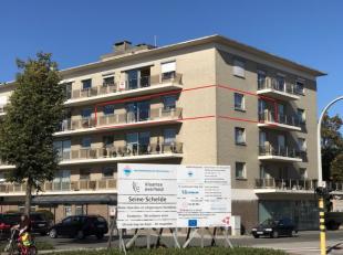 Knap gerenoveerd en heel centraal gelegen 3 slaapkamer appartement met ruim zonnig terras en garage : inkomhal, ruime lichtrijke leefruimte, open keuk