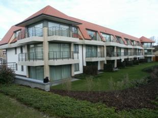 """APPARTEMENT TE KOOP TE DE PANNE : Recent en modern appartement met 2 slaapkamers, gelegen in het groene """"Domein Toscana"""". Gelijkvloers met zonnig terr"""