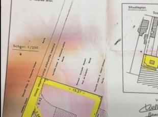 Terrein met garage te koop met een oppervlakte 227m² met uitweg.