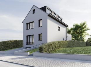 Kraainem, proche de toutes les facilités, très belle rénovation en profondeur d'une villa 4 façades. Elle offre 220 m&sup2
