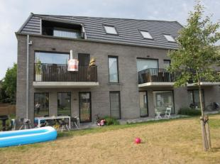 2 Slaapkamer appartement met ondergrondse staanplaats + berging. Appartement 1ste verd met ingerichte keuken, hall, living, terras, berging, 2 slaapka