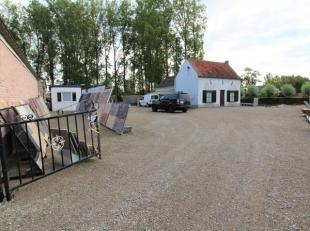Open bebouwing op een perceel van 2890 m², met een unieke ligging in een bosrijke, landelijke omgeving en in een doodlopende straat te Wichelen.D
