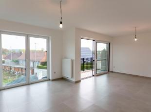 Idegem, Bareelstraat 49 bus 8. Dit ruime en lichtrijke nieuwbouwappartement omvat: inkomhal, woonkamer met eetplaats en ingerichte keuken, twee slaapk